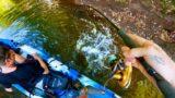 Kayak Fishing Down A Creek
